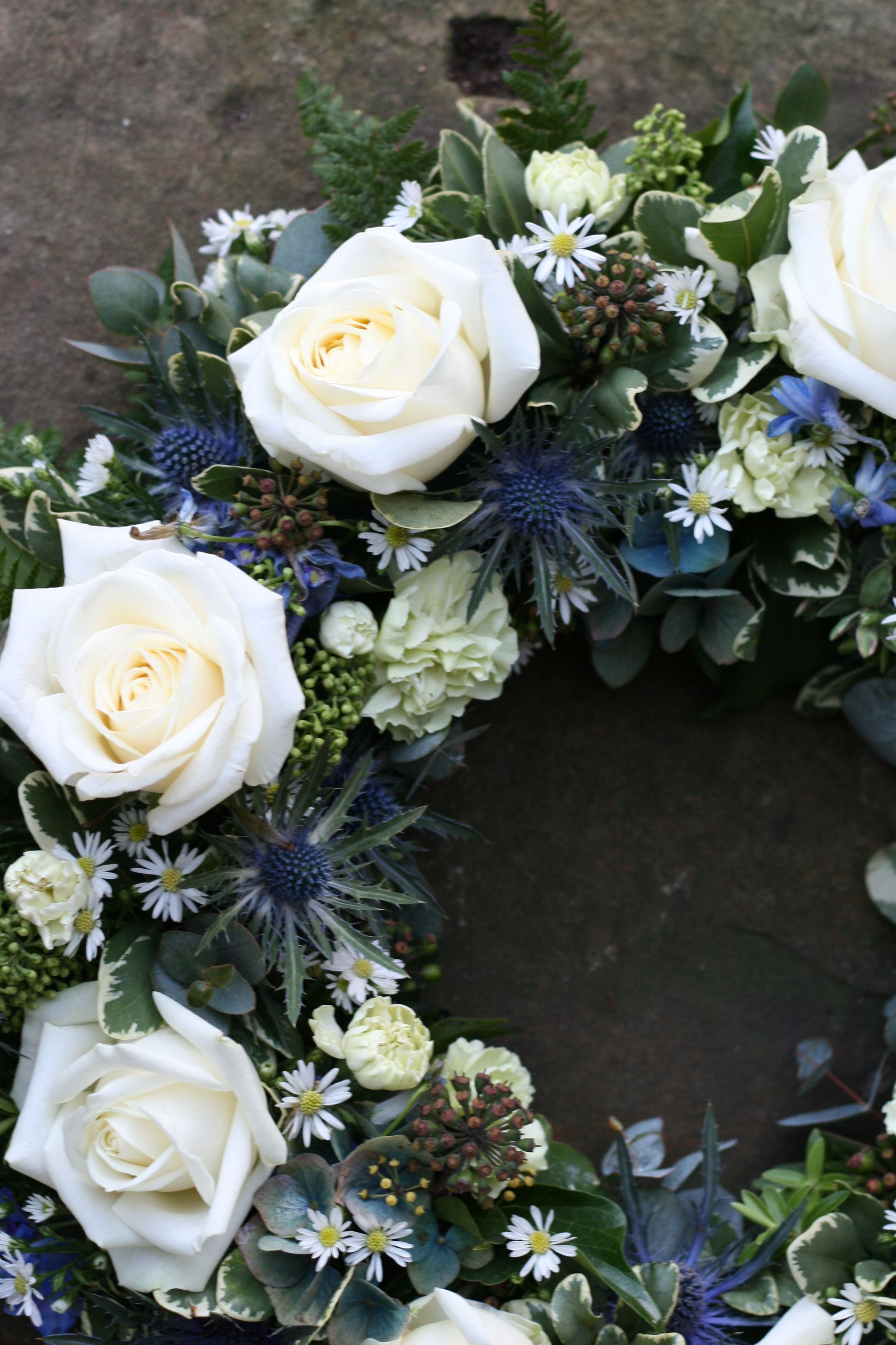 Cream avalanche and blue thistles an elegant tribute for a cream avalanche and blue thistles wreath this is an elegant tribute for his funeral or memorial service izmirmasajfo Choice Image