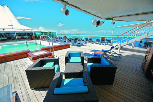 The m/s Paul Gauguin's Le Grill dining venue, as seen from the Pool Bar. www.pgcruises.com