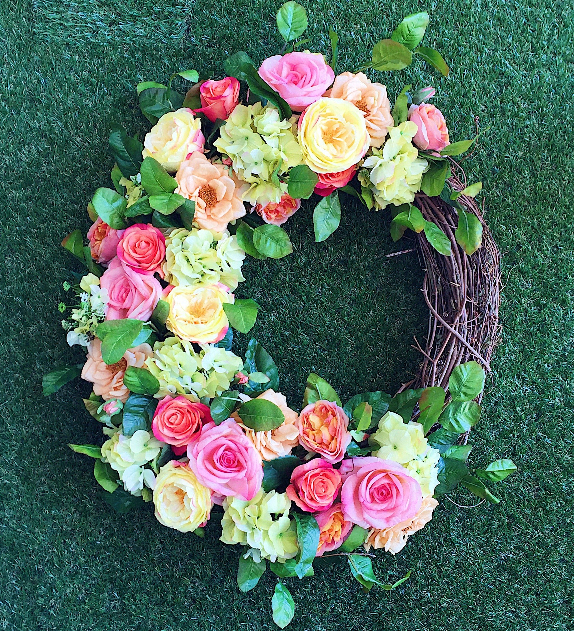Custom floral wreath from our floral design class at Holiday Warehouse