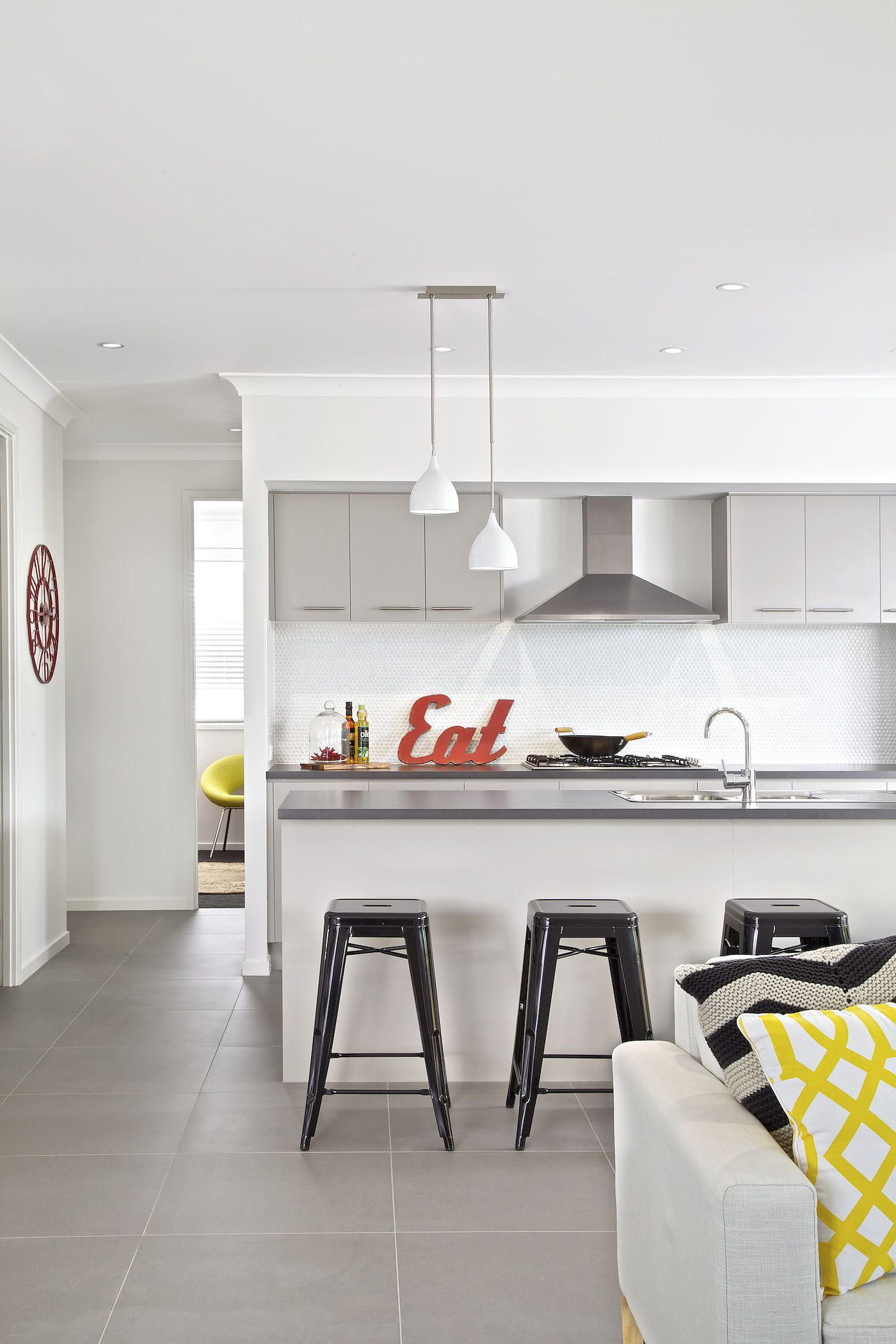 Clarendon Homes. Ascot 32. Kitchen with industrial metal stools ...