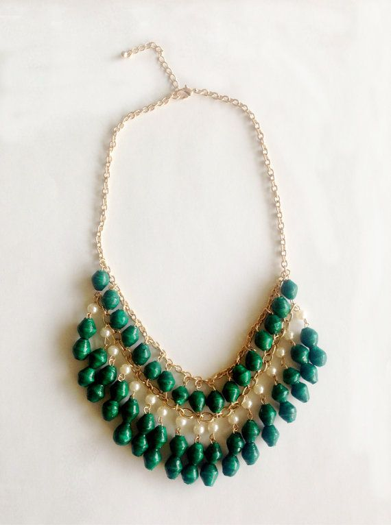 Cascading African beads statement collar necklace in green. Made using recycled paper beads and faux pearls.