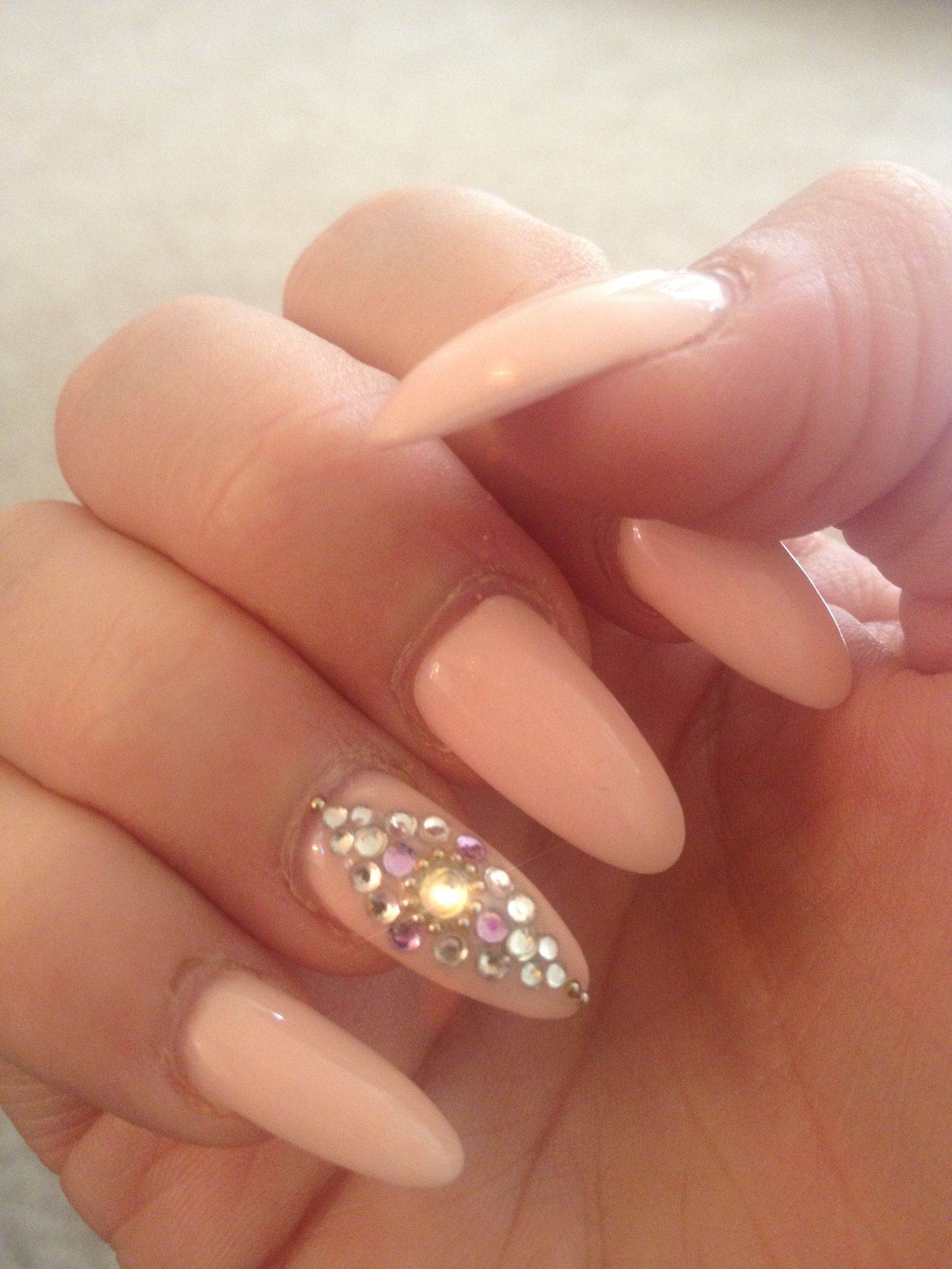 gorgeous pink nails with a diamond crystal embellished nail design