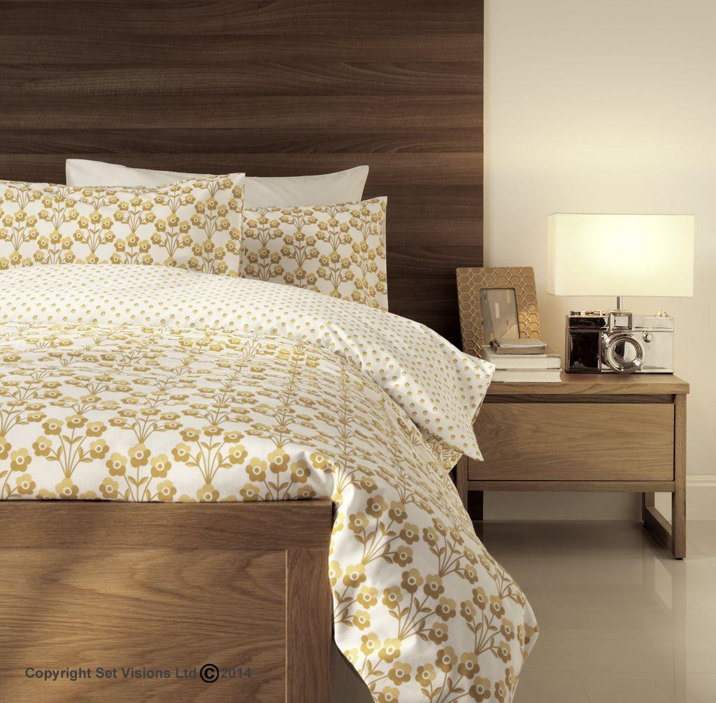 Gold and cream geometric bedding on contemporary walnut