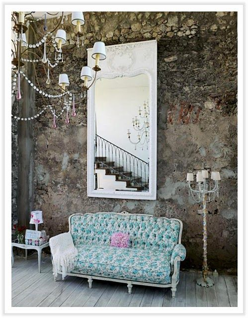Stone Walls. Giant Mirror. Tufted Sofa. Chandelier. Wood Floors. Somehow It  Works