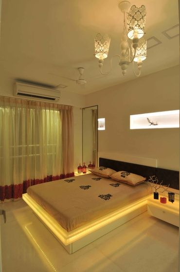 Modern White Bedroom with Neon Light, Design by Sonali Shah, Architect in Mumbai, Maharashtra, India.