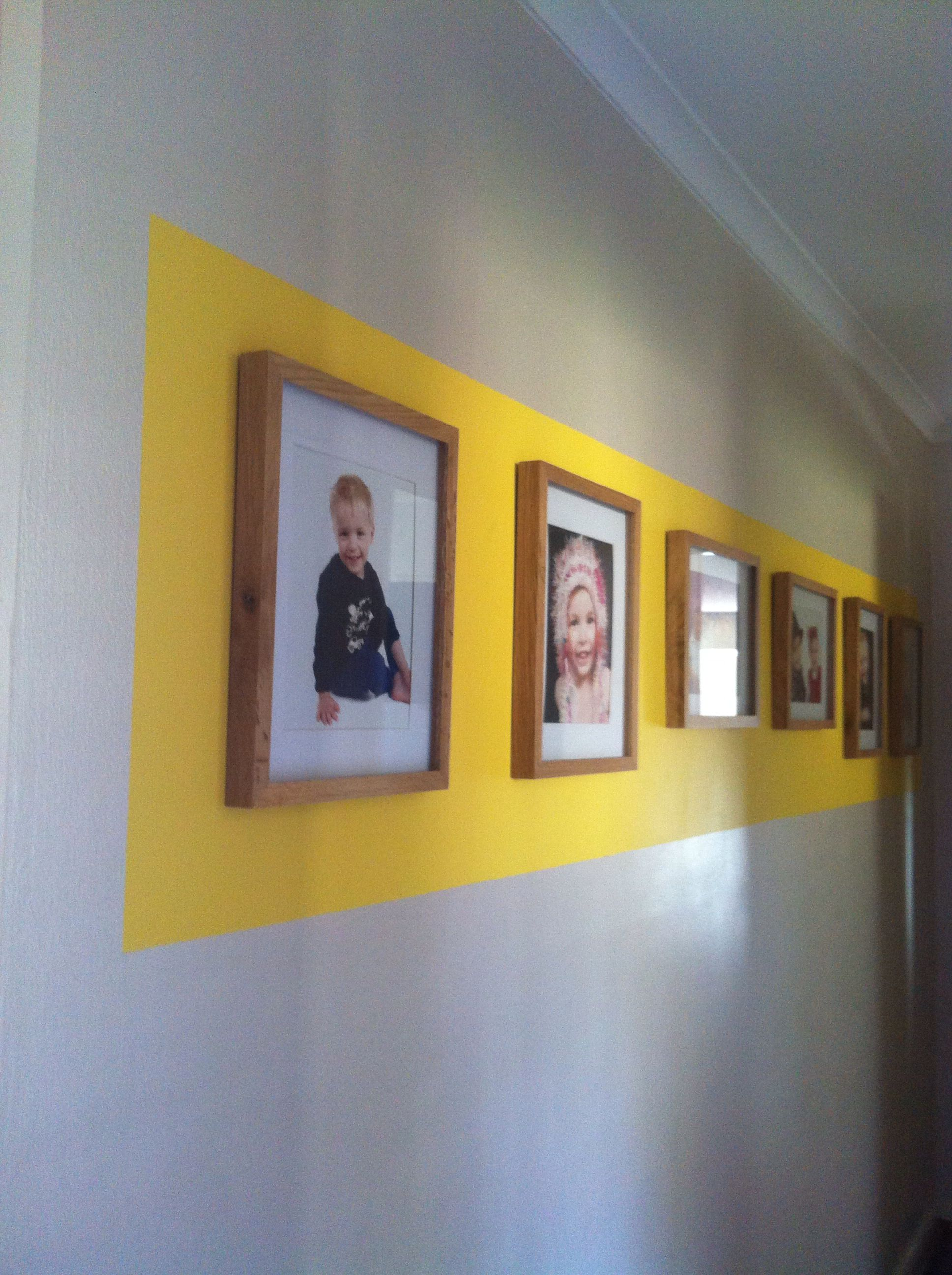 Brighten up your hallway with family photos and yellow border as the ...