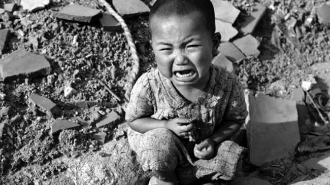 The file photo shows a child survivor of the US atomic bombardment of the Japanese city of Hiroshima on August 6, 1945.
