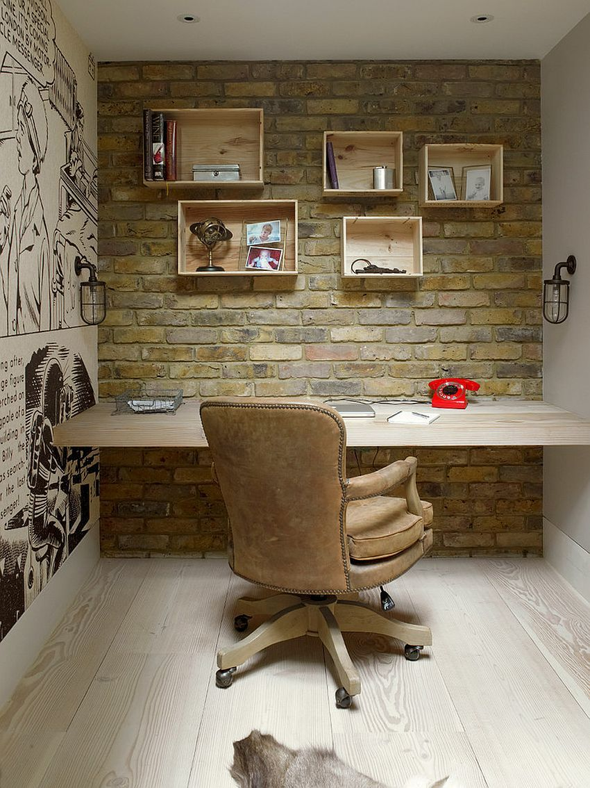 home office with brick wall custom wooden shelves and comic strip styled wall art