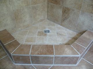 corner shower with tile base..maybe one day in the half bath ...