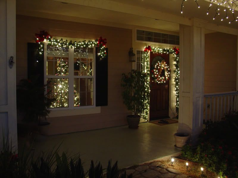 Lighted garland around door and wreath merry christmas y Outdoor christmas garland ideas
