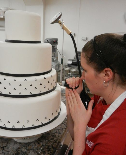 Our Decorator Liz Working On A 4 Tier Cake Boss Cake Decorating
