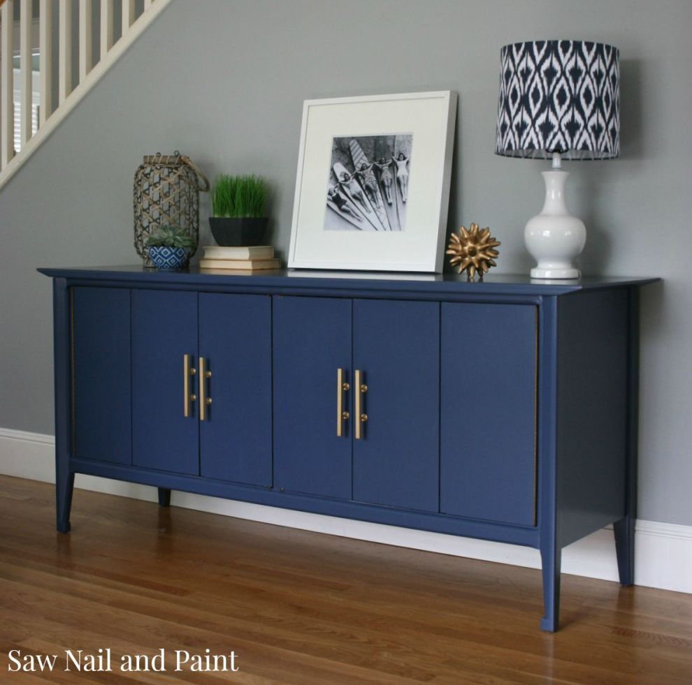 Indigo Blue Mid Century Buffet is part of Mid Century Traditional Living Room - Earlier this spring, I was contacted by a woman in my neighborhood to do a custom refinish on a midcentury buffet she had purchased from Craigslist  I met her at her home to have a look and discuss a design plan  She lives in an adorable Seattle bungalow and plans to use this buffet in    Read more