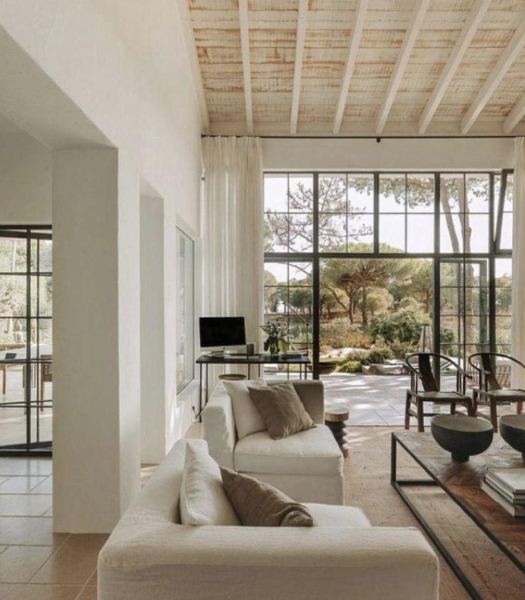 White Washed Wood Ceiling In Living Room With Metal Doors