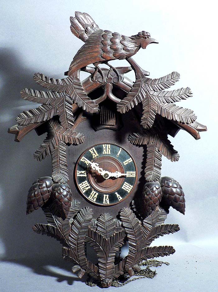 black forest carved wood cuckoo clock bird and fir branches  black forest carved wood cuckoo clock bird and fir branches ca 1930