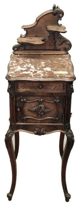 Antique French Louis XV Rosewood Nightstands are getting more scarce with each passing year, since rosewood was harvested in the rain forests for a comparatively limited time and furnishings from that period, in the minds of many experts, represent the epitome of the furniture craftsmanship and fineness of materials that occurred in France during the second half of the 19th century. Circa 1870s. Measures 45.5 x 15 x 15; marble 33.