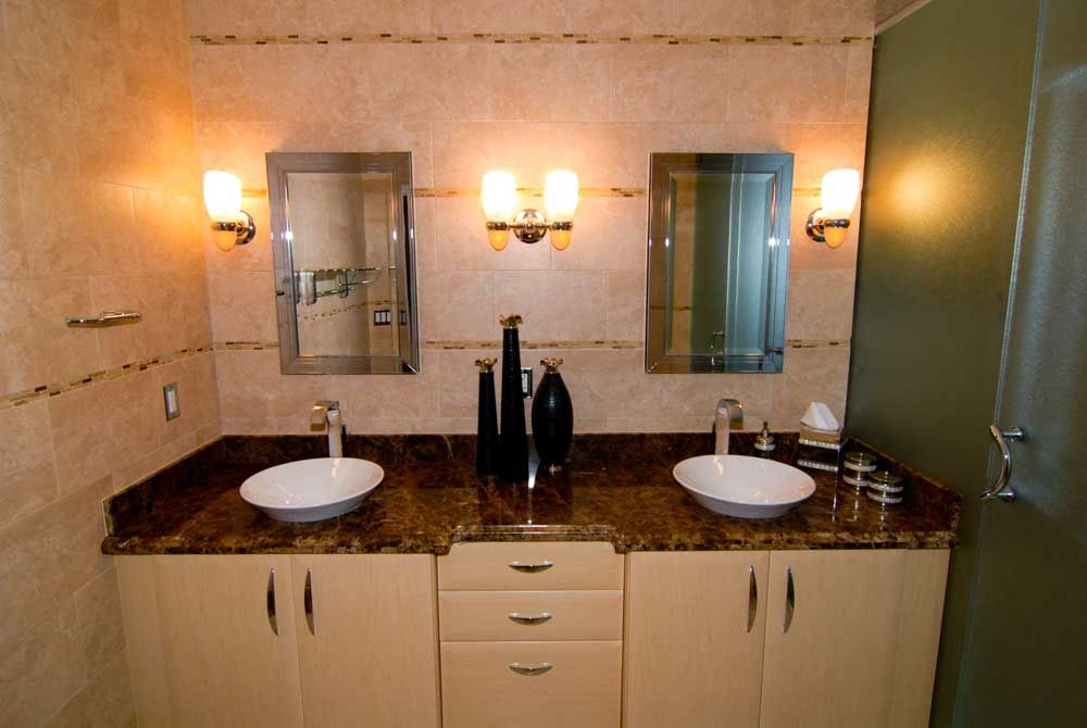 latest wash basins table top with brown granite top connected by double mirrors on beige tile