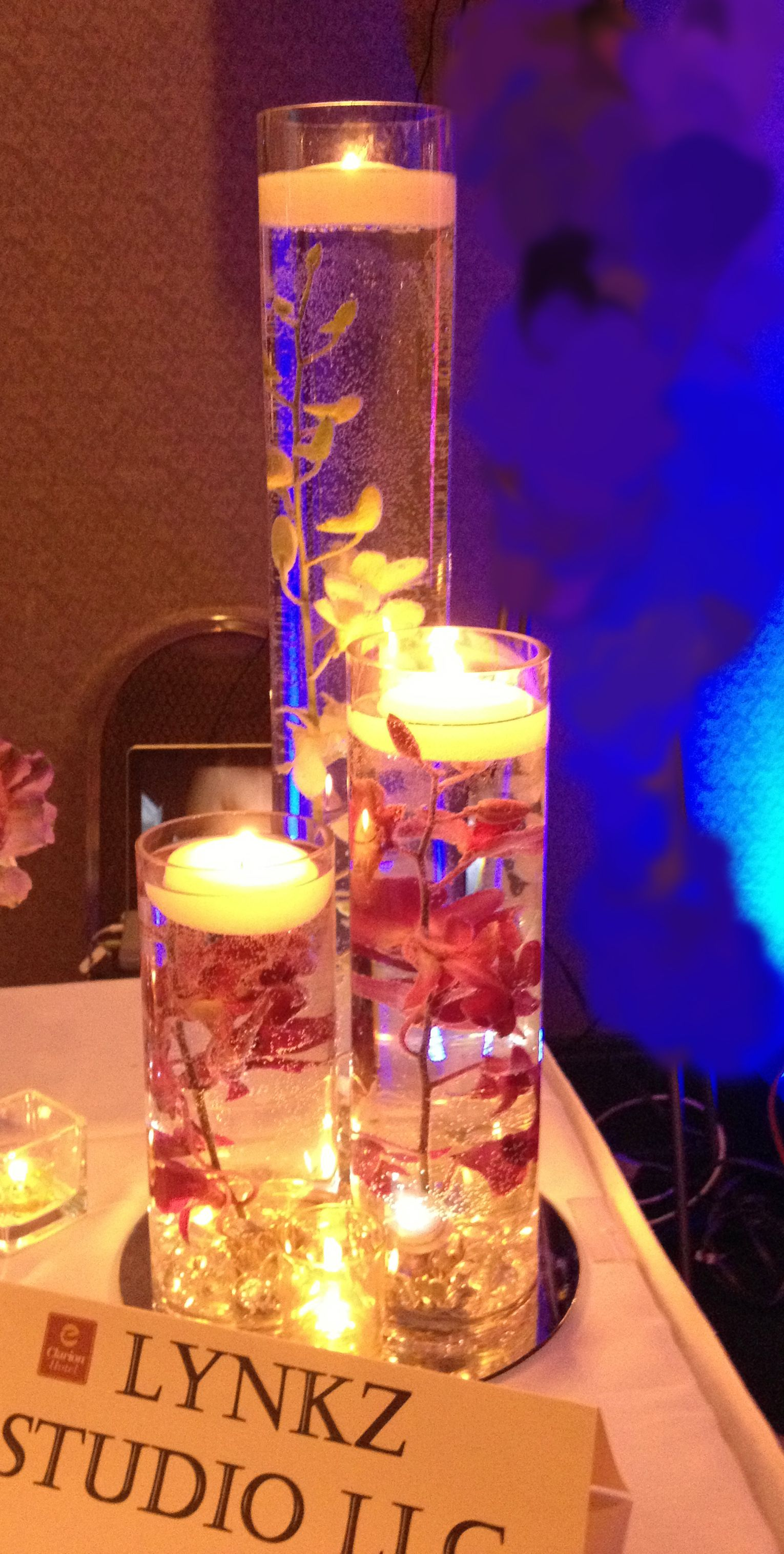 Centerpiece With Dendrobium Orchids Floating Candles And Immersible Led Lights