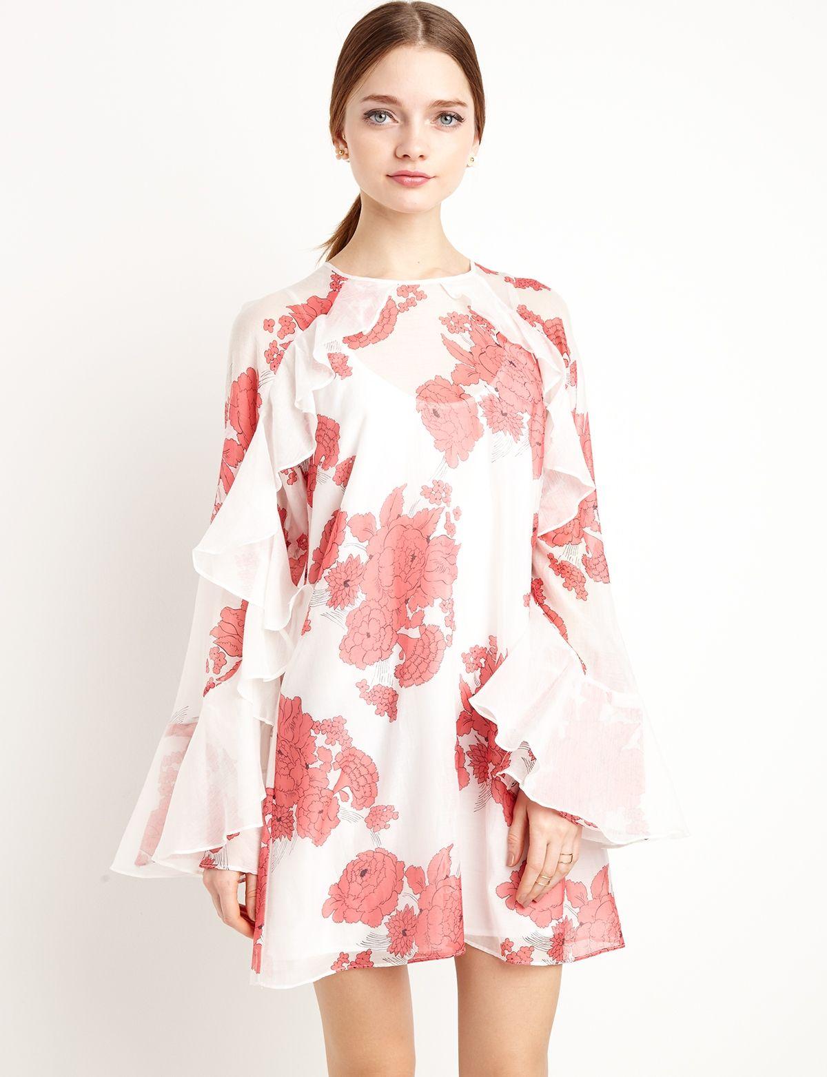 Pretty ruffled floral dress with flared ruffled sleeves. Semi sheer ...