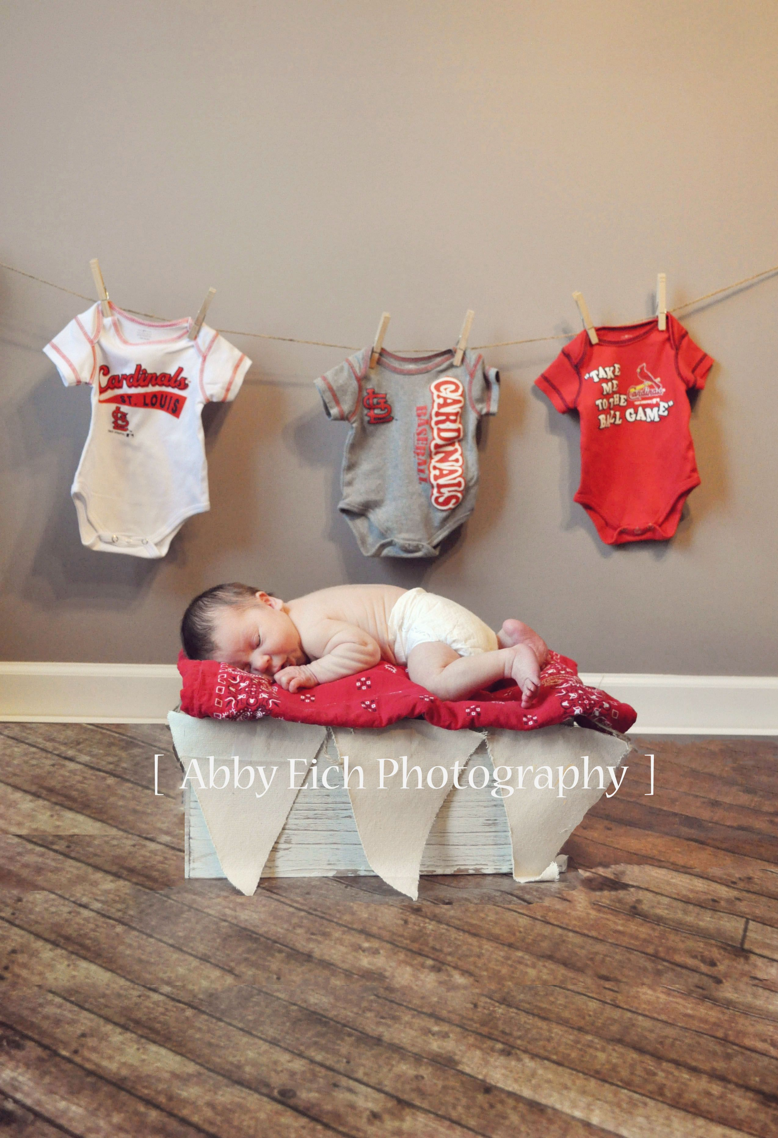newborn photography maybe with three pretty dresses behind
