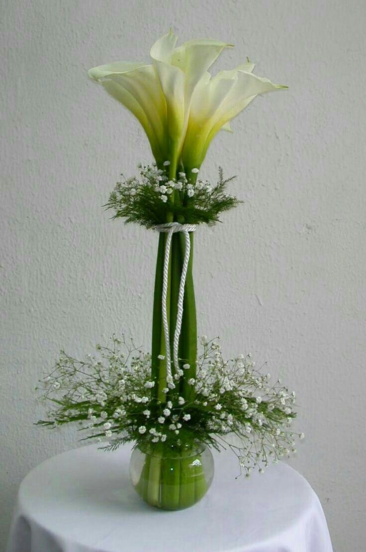 Possible DIY: Calla lilies & baby's breath center pieces. {can possibly be  bound more elegantly}