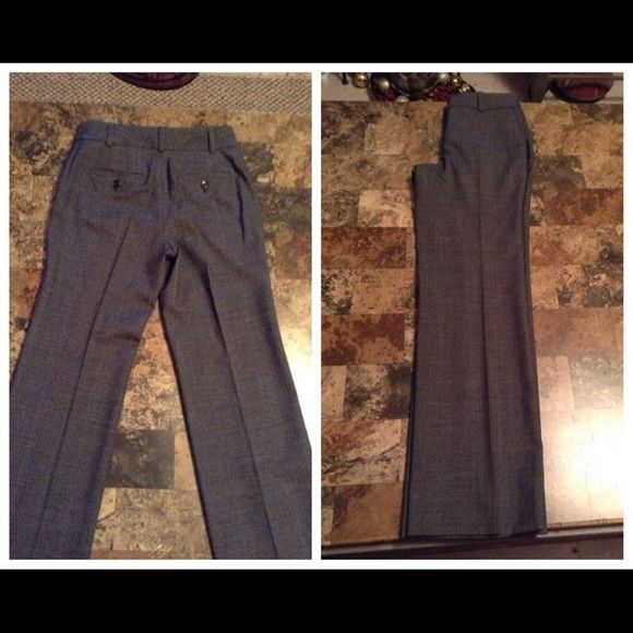 """Ann Taylor Trouser Ann Taylor Trouser is made of 42% Virgin Wool and 35% Polyester and 20% Rayon and 3% Spandex. Lined Pants. Size 0 Petite. The Colors are: Gray/Black Combination. Laying flat """"13.5. Inseam """"30. Rise """"8.5. Length """"38.5. Ann Taylor Pants Trousers"""