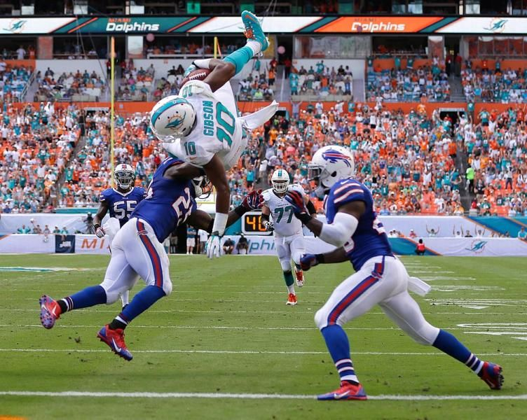 Miami Dolphins wide receiver Brandon Gibson (10) jumps