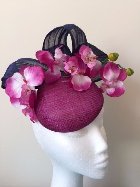 6a644fac8db93 Item: Magenta/Purple button base sinamay fascinator with navy silk abaca  loops and purple/magenta/white orchids. Secured with an elastic.