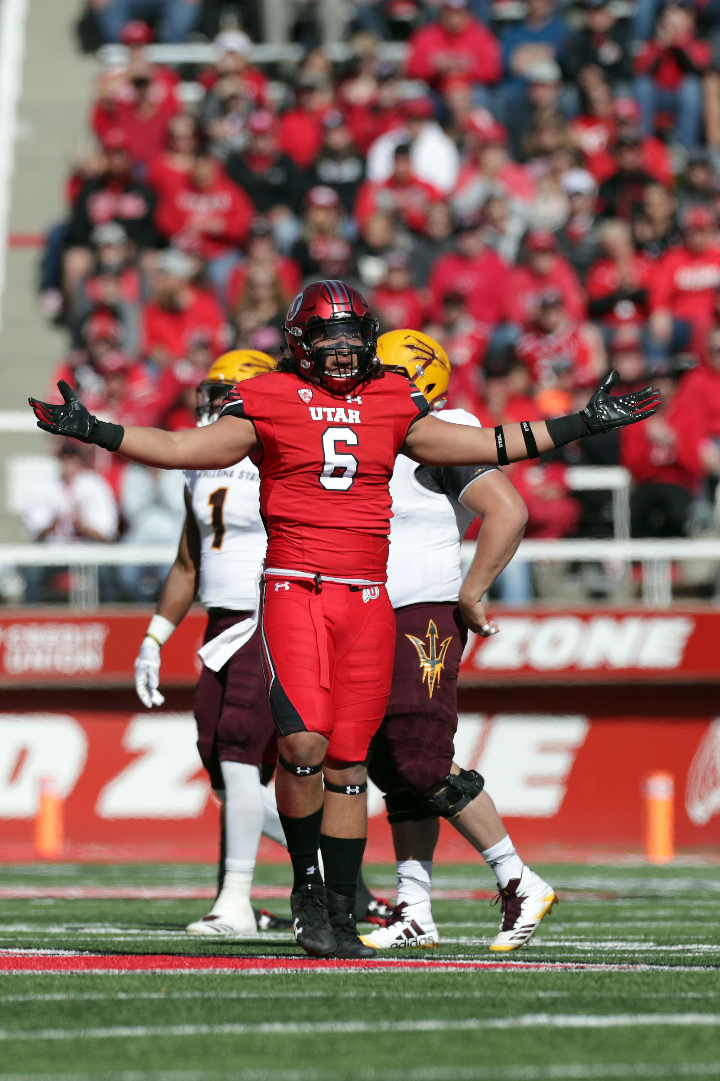 Utah's Defensive End celebrates after a play against