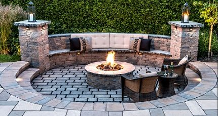 Sunken Patio With Fire Pit And Pillar Flanked Retaining Wall Seating.