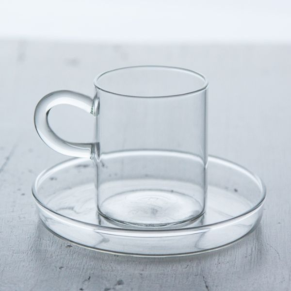 PIUMA ESPRESSO CUP & SAUCER / Ichendorf - Innovative techniques give Ichendorf glass an ethereal transparency and a high refraction index. Forms and materials become ineffably light, objects with a genuine shine that add a delicate elegance to any home. The Piuma espresso cup and saucer are embodiment of these concepts.