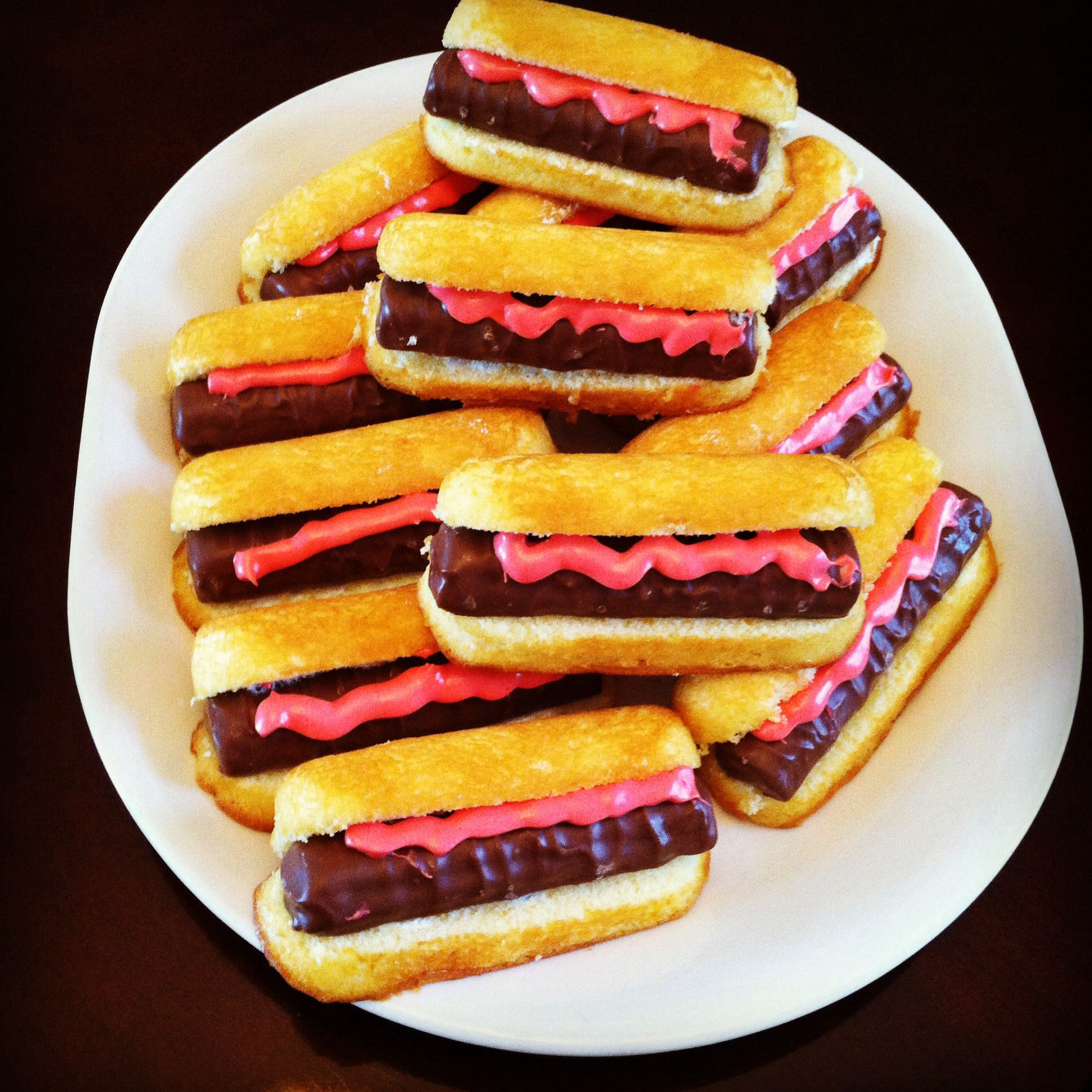 dessert hot dogs made with twinkies twix and frosting a