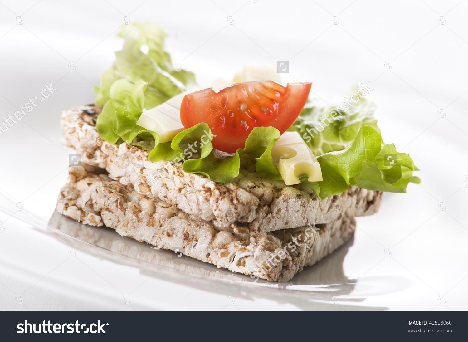 Healthy rice cake with salad cheese and tomato close up