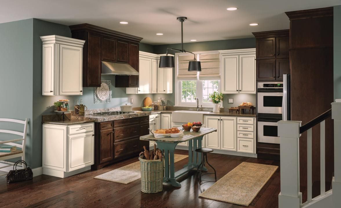 This Inviting Rustic Aristokraft Kitchen Mixes Toasted Antique With The Rich Wood Tones Of Rustic Kitchen Antique White Kitchen Antique White Kitchen Cabinets