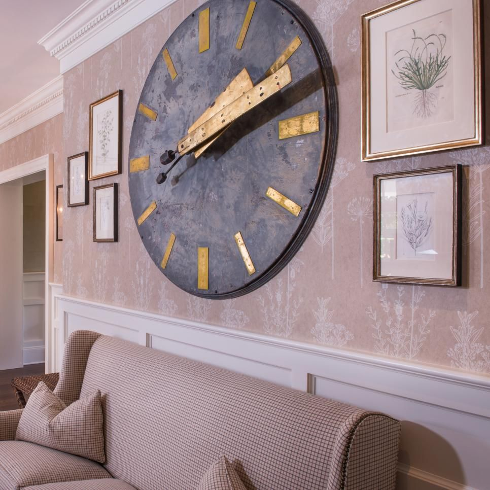 This inviting entrance hall features a large metal wall clock nyc interior designer residential decorator new york city decor amipublicfo Gallery