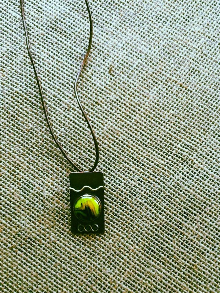 Colorful alternative to an August birthstone necklace. Glass and metal, handmade by NC artist; now available at THE WHITE STAG in downtown Matthews, NC. www.thewhitestagmatthews.com