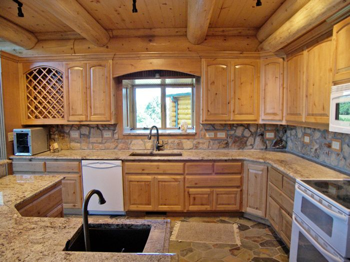 rock backsplash in cabin kitchen kitchen features stone