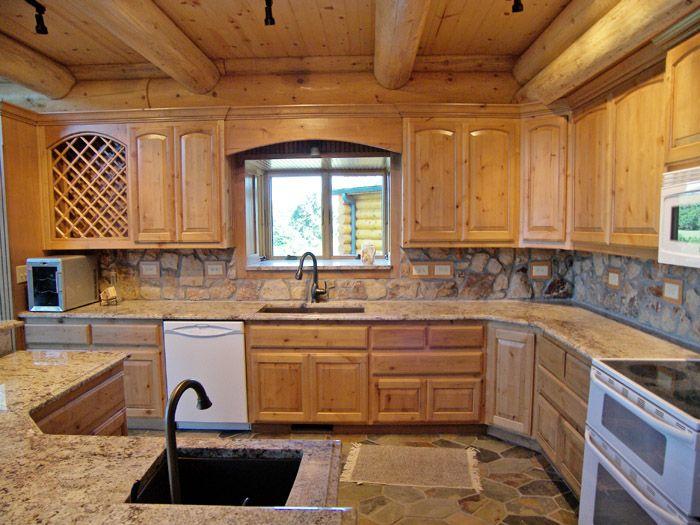 Rock Backsplash In Cabin Kitchen Kitchen Features Stone Backsplash With Good Amount Of Electri Log Cabin Kitchens Log Home Kitchens Kitchen Backsplash Images