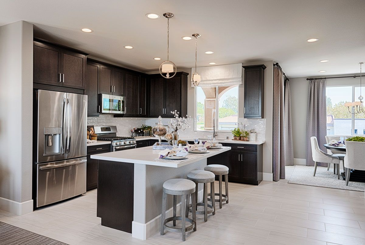 Rich Dark Cabinets Balanced By Light Tile Flooring Countertops