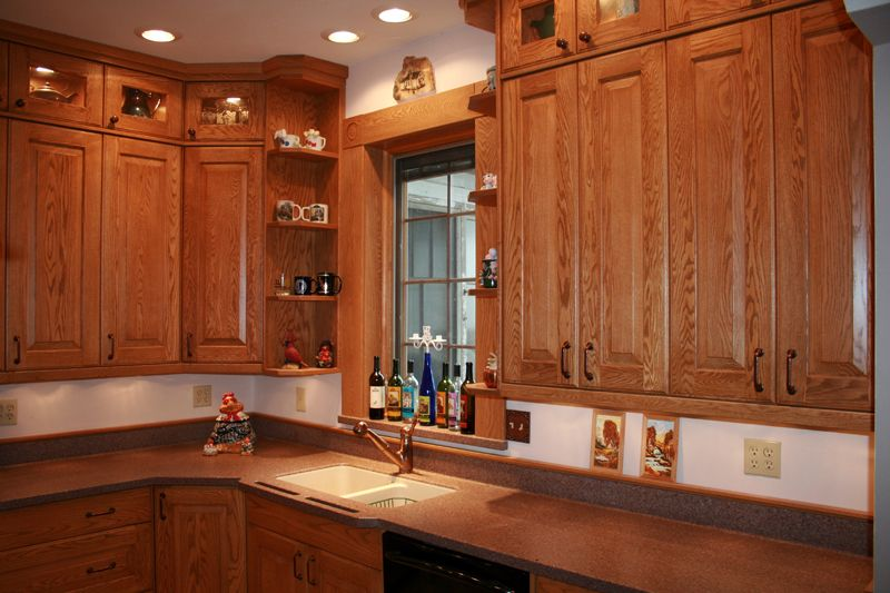 red oak kitchen cabinets pictures of with lg hi macs solid surface countertops