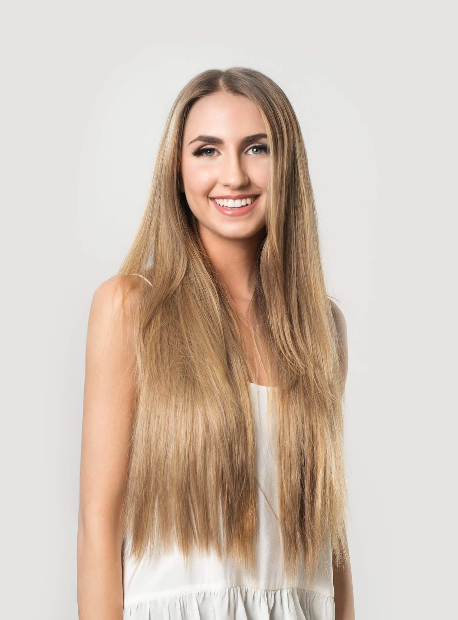 Instantly Transform Your Hair With Seamless Dirty Blonde Clip In