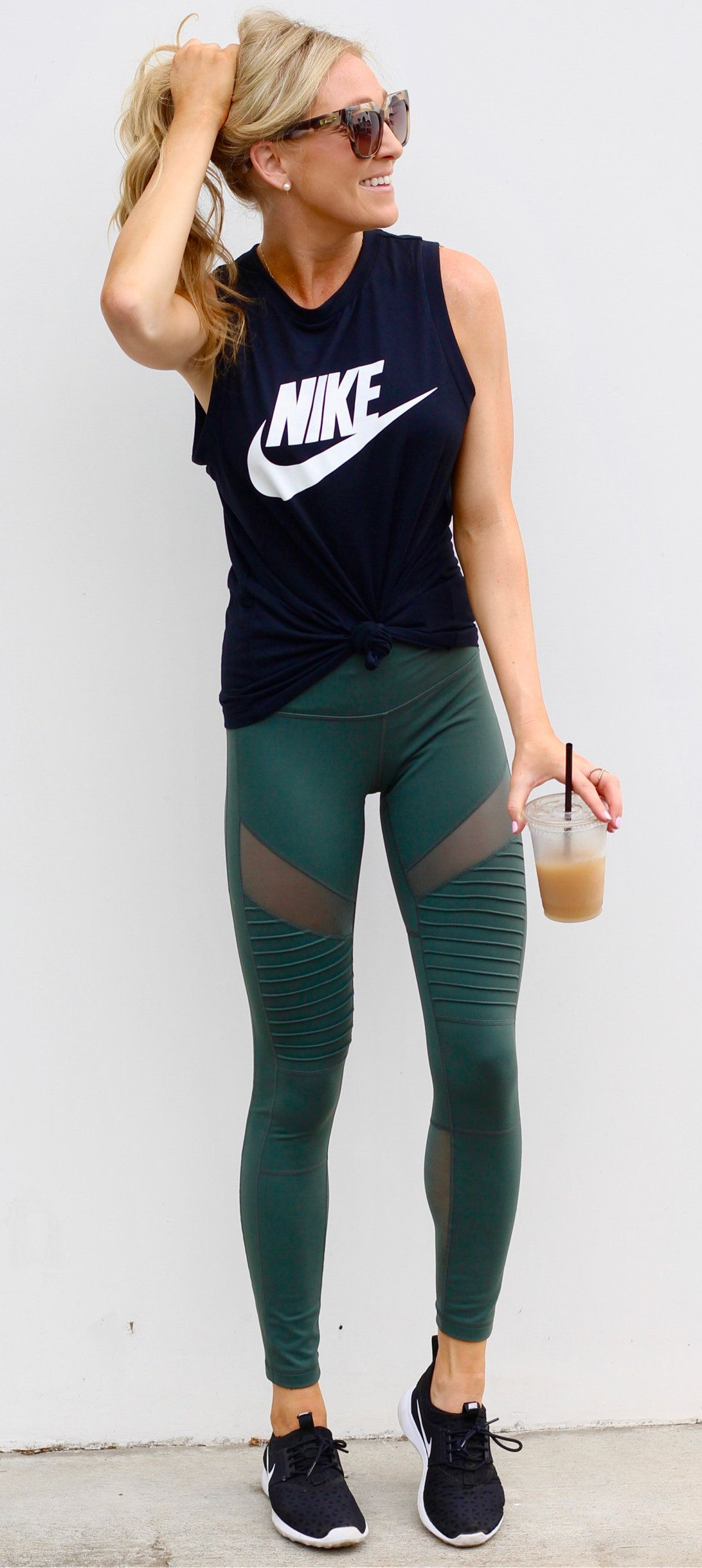 82759919e452f #fall #outfits women's black crew-neck Nike printed sleeveless shirt, green  tights, and pair of black-and-white Nike Roshe Run sneakers outfit