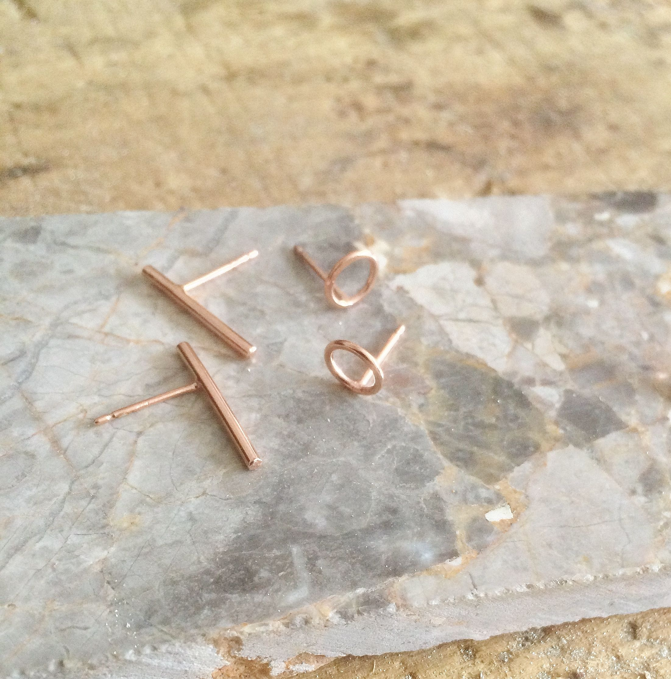 Rose gold tiny circles and bar earrings. #rebeccagladstonejewellery #rosegold #minimaljewellery #barearring