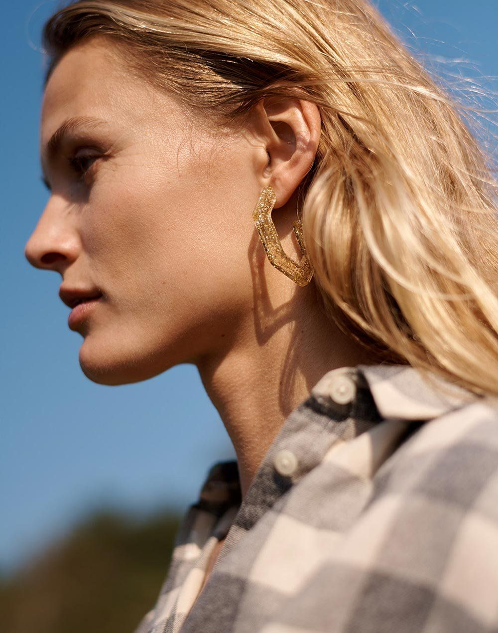 71b6a884a2a6c1 madewell glitter oversized geometric hoop earrings worn with central shirt.