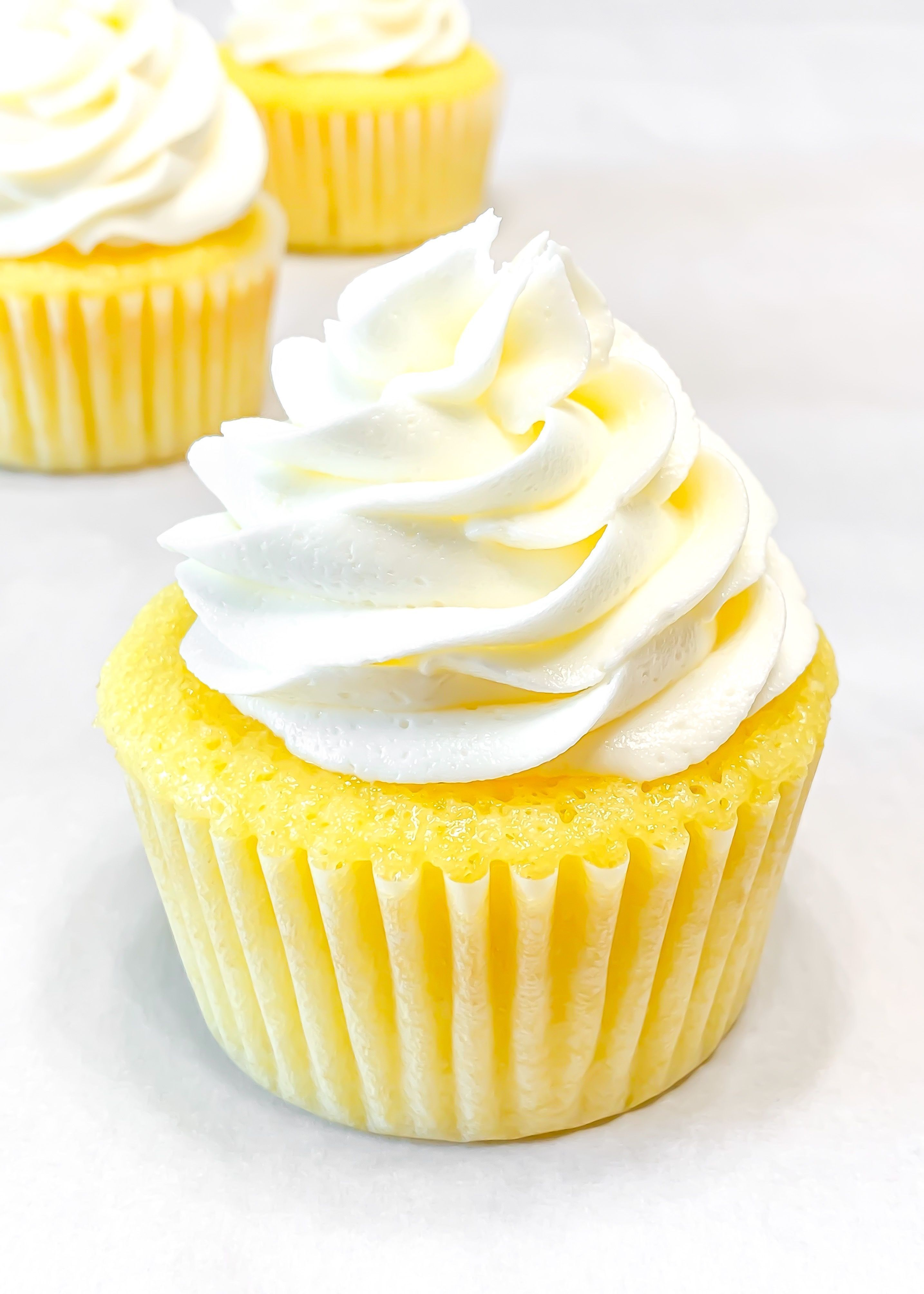Lemon Cupcakes with Lemon Buttercream #lemonbuttercream These lemon cupcakes are soft and moist, made with lemon extract and zest to create the bright lemon flavor. After cooling, the cupcakes are decorated with a swirl of lemon buttercream and chilled for an hour to really make the lemon flavor shine! #lemon #lemoncupcakes #cupcakerecipe #lemonbuttercream #lemonbuttercream Lemon Cupcakes with Lemon Buttercream #lemonbuttercream These lemon cupcakes are soft and moist, made with lemon extract an #lemonbuttercream