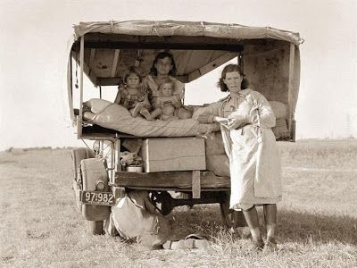"""This is a picture of a family stranded between Dallas and Austin, Texas. The family had left their home in South Texas, and had hoped to reach Arkansas for work in the cotton fields. The family is flat broke, and broken down. The father is trying to repair a tire. The father said, """"It's tough but life's tough anyway you take it"""". Photo was created in 1936 by Dorothea Lange."""
