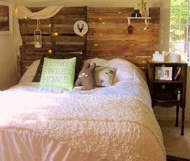 Lantern And Fairy Lights Showing Through Wooden Pallets Headboard