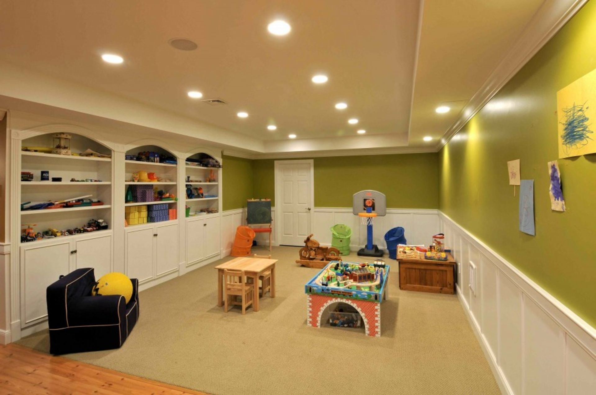 A finished basement with plenty of room for a play area for the kids ...