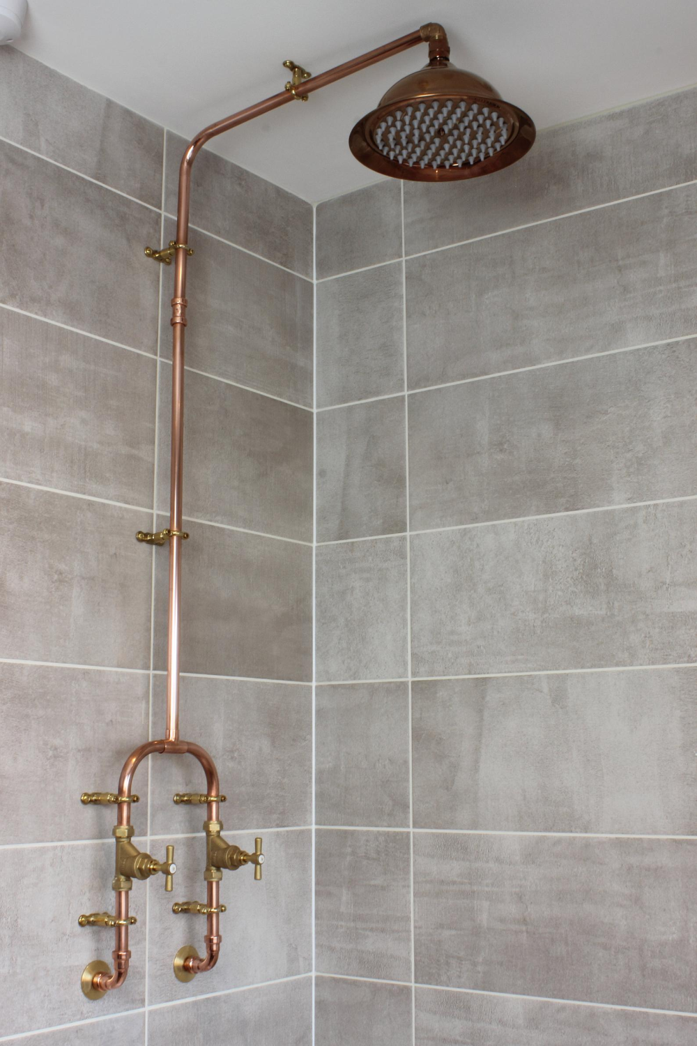 Photo of Copper shower with a fixed head