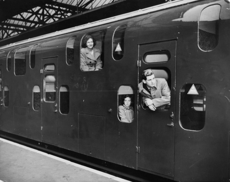 Passengers inside a double-decker train at Charing Cross station, London, 1949.