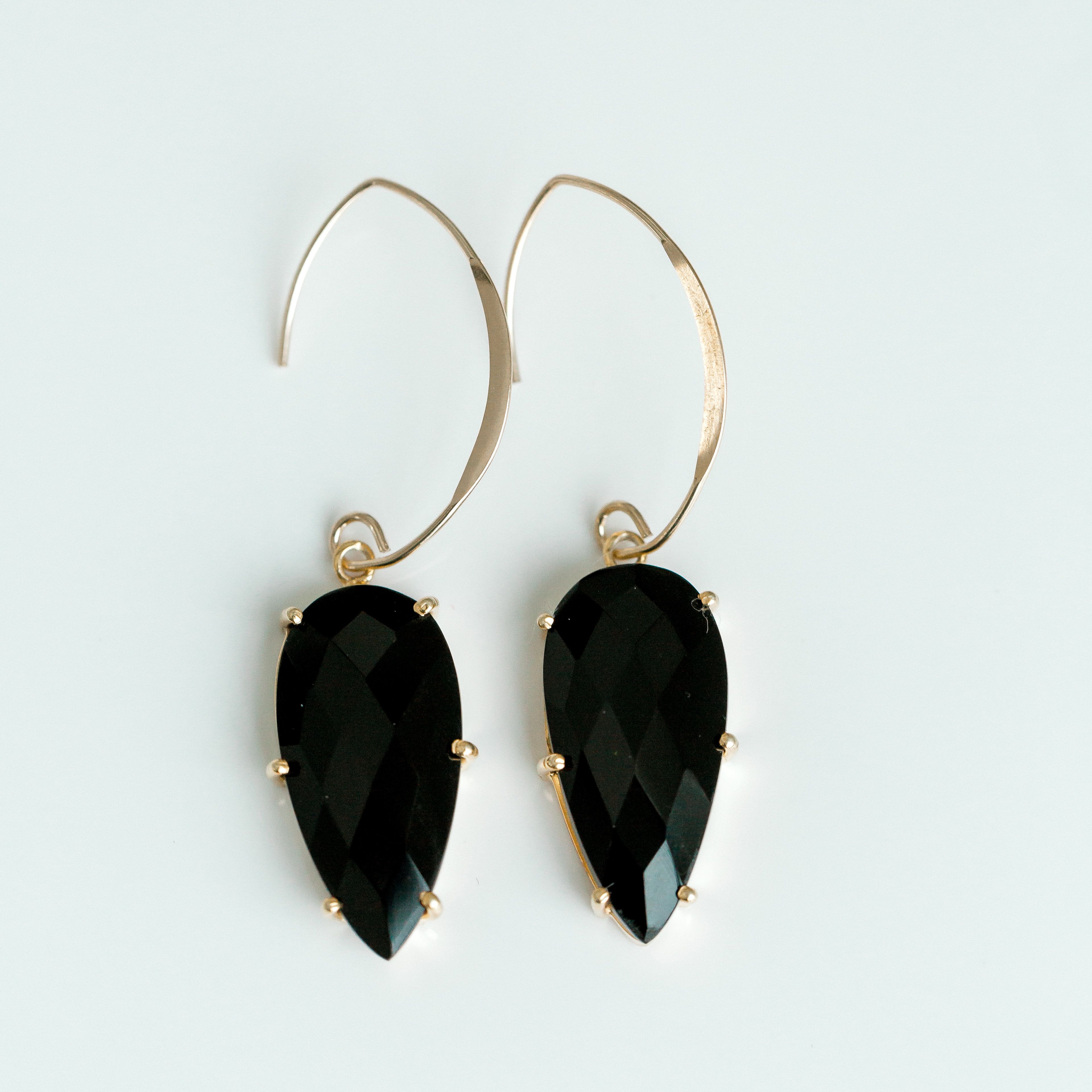 Sterling silver drop earrings set with onyx stones.